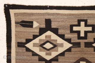 pretty little navajo rug with attractive feather design. local New England find. Good earthy natural colors with no dye run. Thin and floppy handle and clean. Reasonably good condition with one small  ...