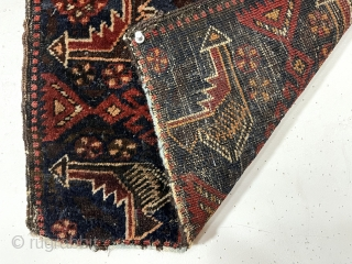Antique little Baluch bagface, sistan I believe. As found, original host hair selvages and top end flat weave with loops. Lower end has guard border tightly cropped with later added cord.  ...