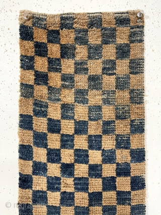 Interesting early Tibetan pile weaving in the classic checkerboard design. Complete little weaving with original selvages. Unclear what this was this long narrow weaving was made for or if this is a  ...