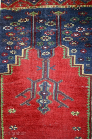 Central Anatolian Prayer Rug with a design that shows Ladik influences,but is certainly an anonymus village weaving. 165x114 cm.W/W. Around 1900. Very good condition with only small, restricted spots of foundation.Full pile all  ...