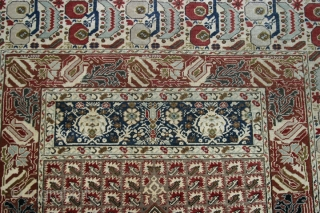 Gördes Prayer Rug. C.1900, or early 20th.cent. 135x185 cm. Full pile, typical Gördes coloring. Classical but very intricate borders. One minimal repair at selvages. Several small damaged spots within the Mihrab, difficult  ...