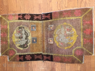 The beauty of this Chinese Saddle rug lies in the richly executed border with endless knot design symbolizing fate and longevity and shou design symbol of  long life flanked by two  ...
