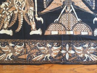 Indonesian cotton Batik wall hanging depicting a scene from wayang kulit(shadow puppet) .