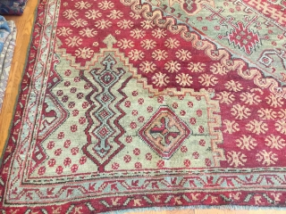 A beautifully conceived Oushak village early 19th Century knotted of very soft wool which with the passage of time has altered to mellowed tones. Size: 10'-2'' x 11'