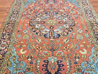 Antique Persian Heriz-4390.  Northwest Persia, size 6 ft. 9 inches by 9 ft. 10 inches, circa 1920, large round medallion surrounded by a Palmettes and flowering vines on the tera-cotta field,  ...