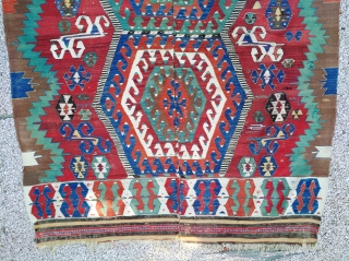Two bands Anatolian kilim, big (333cm x 187cm), colorful, badly sewn by the middle. Priced accordingly to its condition, but unrelated to its beauty