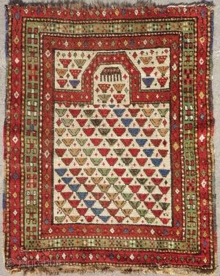 Antique and rare trans-caucasian prayer rug (103cm x 83cm).