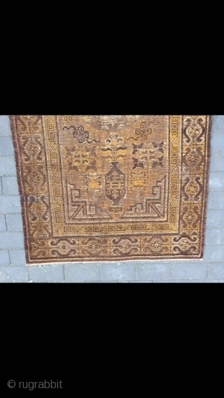 #2023 Xinjiang carpet. It was produced in Khotan area. Late 19th / circa 1900. Brown background with Xinjiang Khotan flowers pattern, some early synthetic color . Wool weft and cotton warp. Size  ...