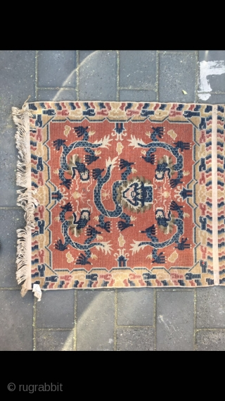 "#2029 Baotou rug, it was produced in Baotou area in Inner Mongolia. A sit mat with back. Red background with lively dragon pattern, lucky cloud salvage. Good age and quality. Size 145*75cm(57*29"")"