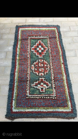 """#2061 Tibet Wangden rug, rare green background with different group flower veins, 万 shape and colorful strip selvage. 165*90cm(64*35"""")"""