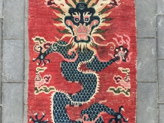 #1716 Tibet rug, it is a very nice Tibet door curtian rug, The background is red, Five-claw dragon rises with lucky clouds around, top of lucky cloud , the water beads spurted  ...