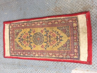 "Ningxia carpet, yellow color with single group ""shou"" veins, around flowers pattern. Packed with red cotton cloth. Good age and quality.size 135*68cm(53*27"") exclude the packing cloth."