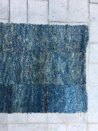 Tibet rug, dark blue color with very tightly row knots, nature color cutting, very good age and condition. Complete one. Size 135*72CM