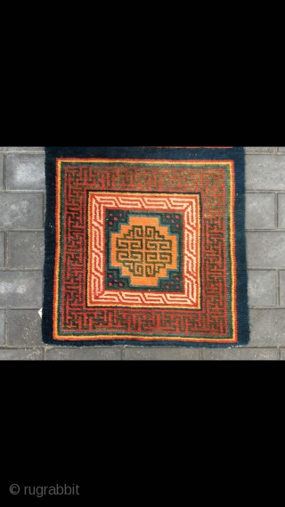 Tibet rug, two square together, each with a medallion pattern around Hui veins selvage. It used by big lama pray in the Temple.Thick knots but very tightly woven. Very good condition .  ...
