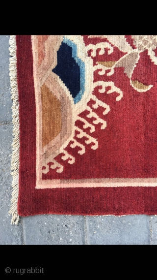 Tibetan rug, red background , very special goldfish pattern with water crystal palace pattern, symbol  of riches and honourhe , the wool  is very good and bright. Size 75*70 cm