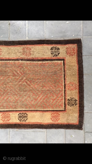 "Xinjiang Khotan rug, it was produced in the  qing dynasty. Size 70*105cm ( 27*41"")"