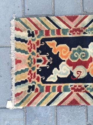 #2013 Tibet rug, dark blue background with colorful lucky cloud pattern. Good age and quality.