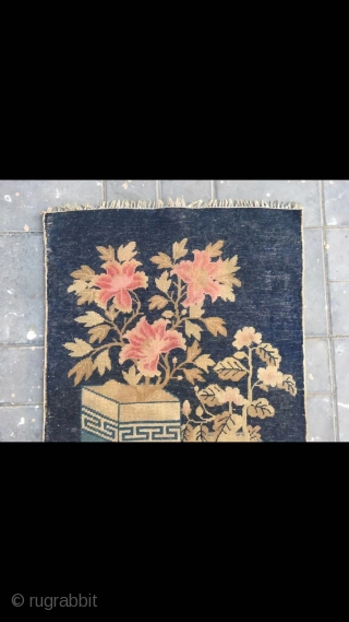"Chinese Baotou rug, blue background with Bogu vase and flowers vines. Good age and condition. Size 66*130cm(26*51"")"