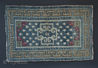 "Small wool rug, Tibet. 22"" (56 cm) by 35"" (89 cm).