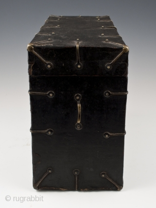 """Black box, Tibet. Wood, fabric, brass. 8"""" (20.2 cm) high, 10.5"""" (26.2 cm) wide, 5"""" (12.7 cm) deep. Late 19th to very early 20th century. This fabric-covered wood box tapers slightly toward the top, as seen  ..."""