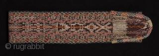 "Sash, Cuzco region, Peru. Wool woven on a backstrap loom. Mid 20th century. 68"" long by 4"" wide."