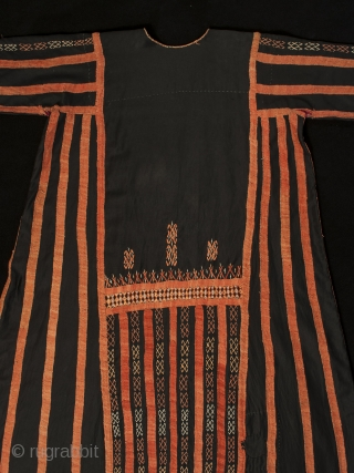 A traditional dress worn by women in the Western Desert of Egypt, this fustan is ornately decorated with thin silver coins, buttons and very fine cotton embroidery. There is a pocket on  ...