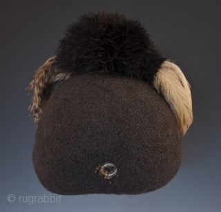 "Emedot Headdress, Karamojong tribe, Uganda/Kenya. Feathers, felted human hair, clay, wire, aluminum rings, 20th century. 8.5"" (21.6 cm) high by 7.5"" (19 cm) wide by 6.5"" 16.5 cm) deep Ex. Merton D. Simpson Catalog notes: ""Amoung a selection  ..."