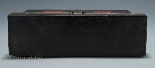 """Carrying box, Japan. Leather, wood, metal. Late 19th century, 8"""" (20.2 cm) wide by 4.5"""" (11.4 cm) high by 2.5"""" (6.3 cm) deep. This mysterious little box was used as a carrying case for small cylindrical objects,  ..."""