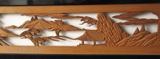 Antique Japanese Ranma (transom) Antique Japanese wood ranma (transom) with a black lacquer frame. The center panel is carved with a landscape scene of a bridge with pine trees and rock formations.   Dimensions:  ...