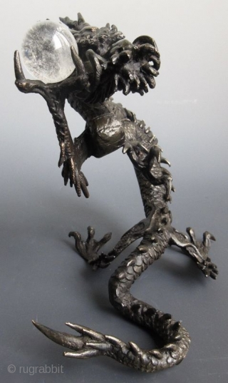 Japanese Bronze Dragon with Crystal Ball Japanese bronze sculpture of a coiling dragon, holding a clear quartz crystal ball in its raised claw. The foot is cast with the two character seal of  ...