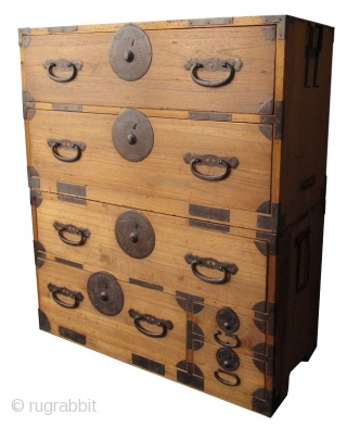 Antique Japanese Two Section Kiri Tansu Japanese two section tansu made of Kiri (paulownia) natural finish wood. With hand forged iron hardware incised with motifs of cherry blossoms and fans.   Meiji period (1868-1912)  ...