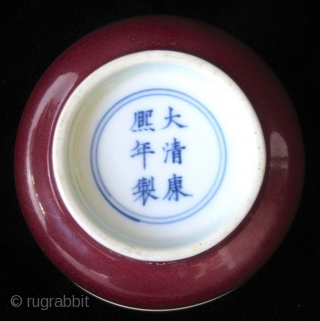 Antique Chinese Oxblood Porcelain Bowl   Beautiful Antique Chinese porcelain bowl with oxblood underglaze. The edges of the foot left in buff, with Kangxi mark in cobalt blue within double rings.  Overall in  ...
