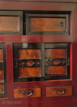 Japanese Edo 2 Section Kanazawa Mizuya   Antique Japanese 2 section 6ft Mizuya with dark red lacquer frame made of Hinoki (cypress) wood, with Sugi (cedar) sides, and Keyaki (elm) burl hardwood front panel  ...