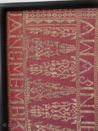 Framed Balinese Kampuh Songket Men's Ceremonial Wrapper  Antique framed Balinese kampuh songket, a men's ceremonial wrapper cloth, handmade with supplementary weft silk, cotton, gold and silver thread. The red ground cloth with gold  ...