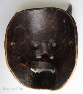 Antique Japanese Hannya Noh Mask  The Hannya (般若) mask in Noh theater represents a jealous female demon. She possesses two sharp bull-like horns, metallic gold eyes, and a leering mouth with jagged teeth.  ...