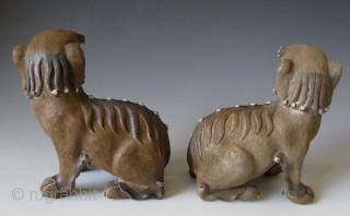 Pair of Chinese Antique Shiwan wear Fu-dogs  Antique Chinese pair of fu-dog (or fu-lions) hand made of Shiwan stonewear ceramic. Shiwan ware (Chinese: 石灣窯; pinyin: Shíwān yáo; Cantonese Jyutping: is Chinese pottery from  ...