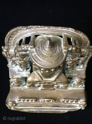17th Century Silver Inlaid Brass Jain Shrine  Ancient Indian Jain religious shrine, the central Jina surrounded by multiple celestial nymphs with two elephants at the top on either side of the parasol. This  ...