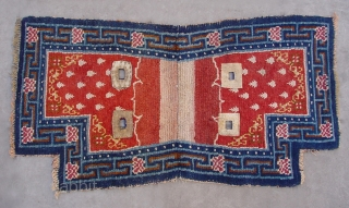"No.CL038 * Tibetan Antique ""Footprint of the Frog"" Saddle Rug, Age: Early 19th Century. Size:66 x 119cm (2'2""x3'11""). Origin:Tibet. Background Color:Reds. wool/wool."