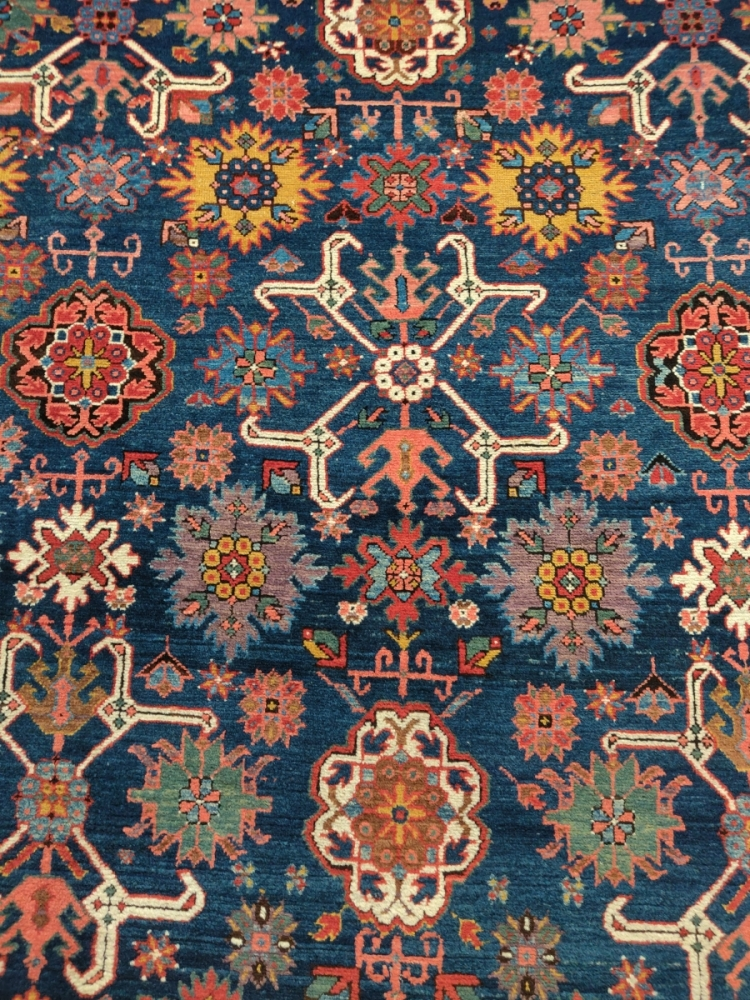 Sadegh Memarian's colorful Caucasian kelleh carpet