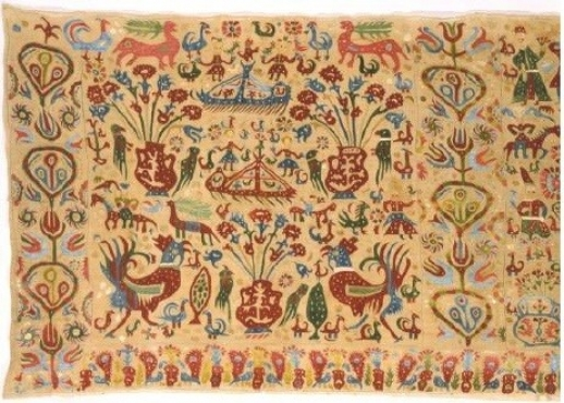Embroidered bed valance, decorated with an impressively complex representation. From Ioannina in Epiros. The five panels of the valance are embroidered all over with towers, horsemen, human figures, ships, flowerpots, peacocks and other birds, double-headed eagles, flowers and plants. The composition is undoubtedly narrative, although hard to interpret. 18th c. 0 .72x3.53 m. Gift of Beatrice Cook. (ΓΕ 6308) image and text copyright Benaki Museum