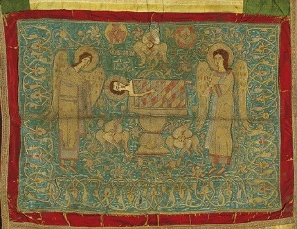 Aer, veil embroidered with gold thread, a liturgical article used to cover sacred vessels on an altar. The Melismos, a symbolic representation of the Holy Eucharist, is portrayed on it with the Child Jesus on a paten below an asteriskos, a star-shaped frame surmounted by a cross, and flanked by adoring angels, seraphim and flowers. Second half of the 16th c. 0.60x0.68 m. (ΓΕ 9340) image and text copyright Benaki Museum