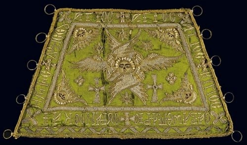 Gold-thread embroidered cuff portraying a six-winged angel and with a liturgical inscription. 19th c. H. 0.15 m. (ΓΕ 34222)   image and text copyright Benaki Museum