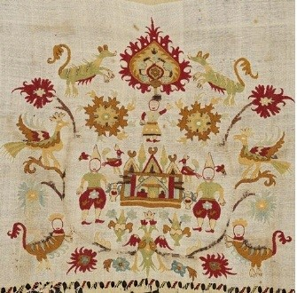 Embroidery on a bridal sheet from Skyros, an island in the Sporades. Abundant floral decoration surrounds the central architectural subject: the depiction of an enviable residence with birds, mythical beasts, human figures, and the apotropaic-talismanic symbol of a double-headed eagle. 18th c. Gift of Mari Zarifi. (ΓΕ 8484) image and text copyright Benaki Museum