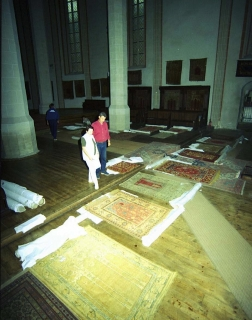 Organizing the rugs before photographing, The Black Church, Brasov