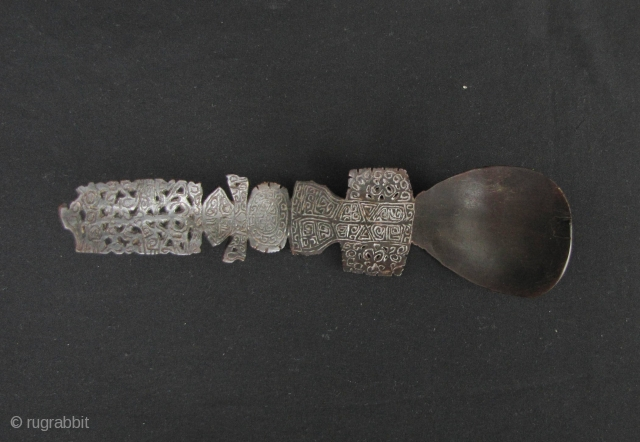 Timor Carved Buffalo Horn Spoon  Classic fine and rare intricately carved heirloom buffalo horn spoon from Timor, Lesser Sunda Islands. This piece dates to late 19th early 20th century and is in excellent  ...
