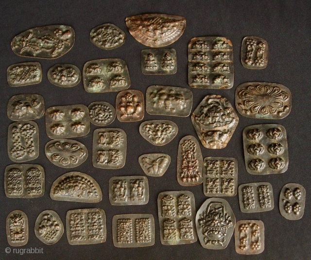 Buddhist Charms: Quirky and eclectic collection of 35 small repousse auspicious good luck tokens. These were collected in Dali, Yunnan, China in the late 1980s. No two are exactly alike and they  ...