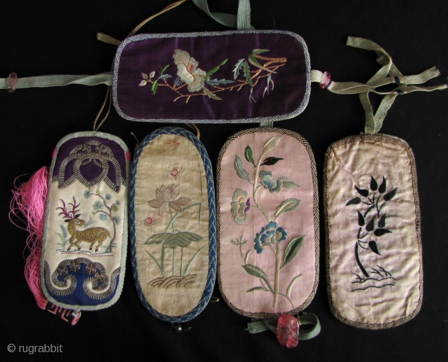 Collection of 5, circa late Qing Dynasty, embroidered glass cases. Eyeglasses were always considered a luxury status item, since not everyone who needed them could afford a pair and they were emblematic  ...