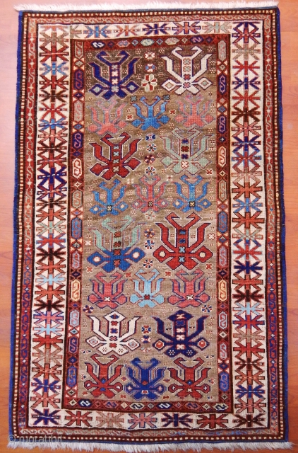 İAntique Caucasian Rug (back grount camel wool change it was )