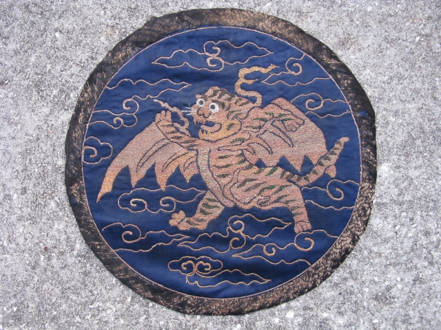 Antique Chinese embroidered roundel, fine couching of metal threads and peacock feathers on blue silk, originally the flying tiger emblem was used on military banners in the 17th and 18th centuries, this  ...