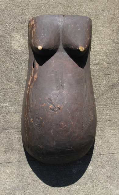 Vintage African mask, a body mask of the Makonde People, Tanzania, a pregnant female body with swollen belly and ample breasts, exhibiting ritual scarification, these were worn by young men in coming  ...